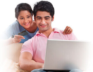 Photo of a couple using a laptop